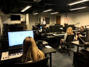 GA students work with computers during class in the D-Media lab.