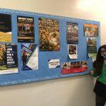 Maya Posing in front of Bulletin Board