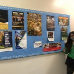 Maya Posing in front of Bulletin Board